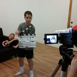 kids w camera screen clapboard actor